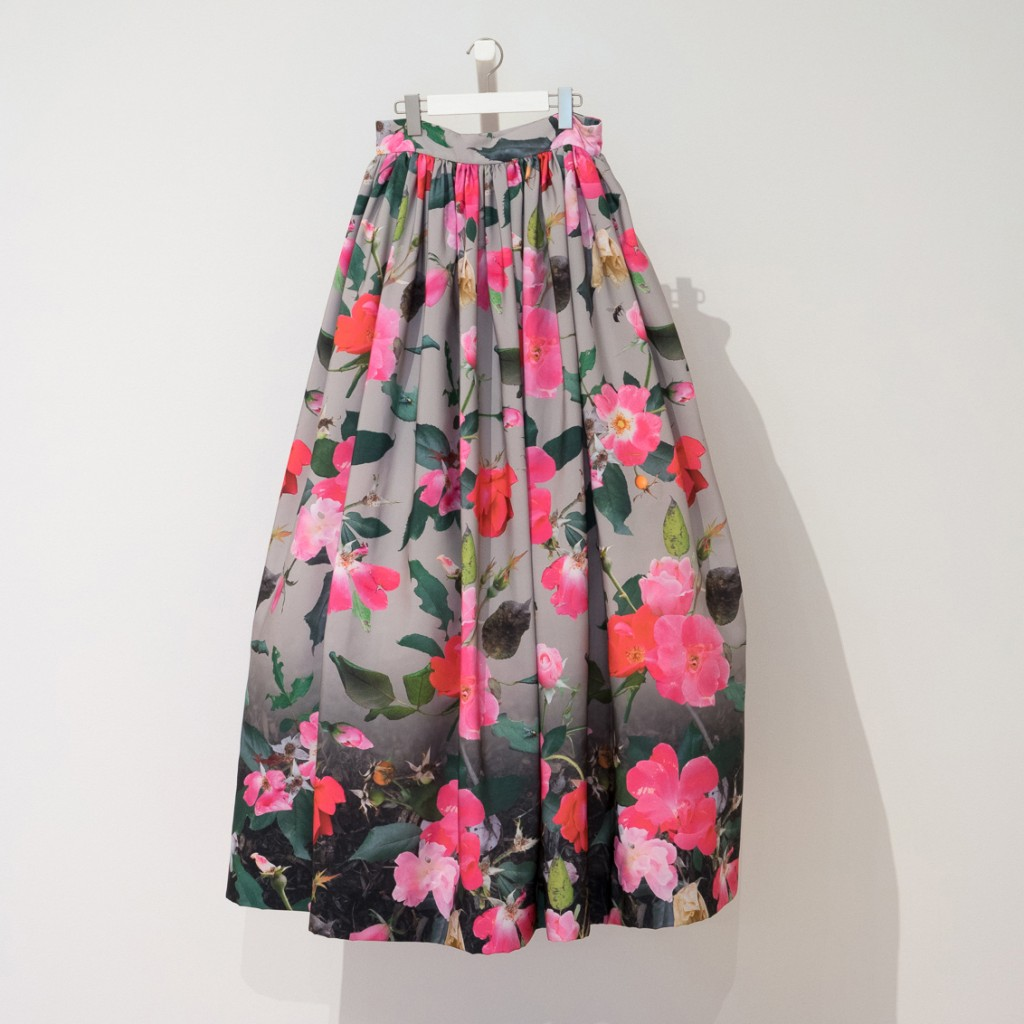large, floor-length skirt with a floral pattern of bright pink roses
