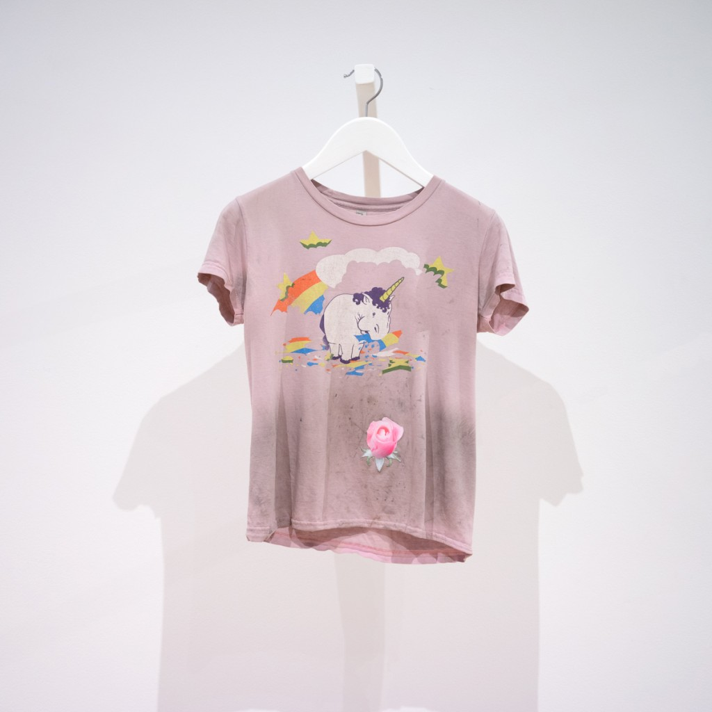 pale pink shirt with a unicorn eating a rainbow and a rose bud patch