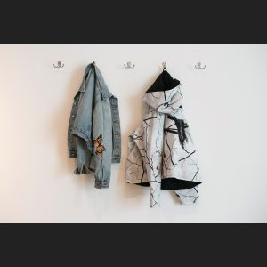 artist-designed and -altered jackets at the entrance to Make Yourself at Home