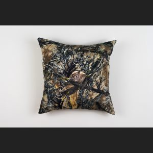 Camouflage pillow with a rabbit peeking out from between brances. Art work by Stephanie Lynn Rogers