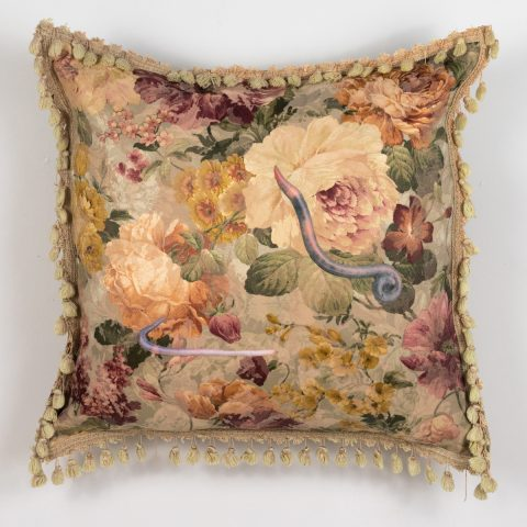 throw pillow with worm imagery appliqued on a vintage floral with tassels by Stephanie Lynn Rogers