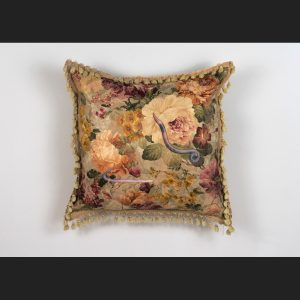appliqued imagery of worms on a floral pillow by artist Stephanie Lynn Rogers